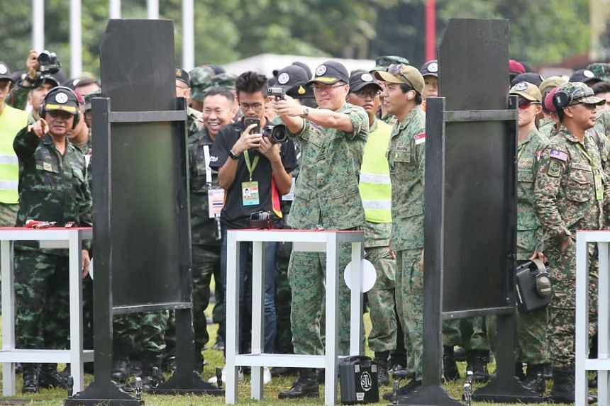 Chief of Army, Major-General Melvyn Ong getting ready for the Pistol Novelty Shoot at Nee Soon 500m Range on Nov 22, 2017.