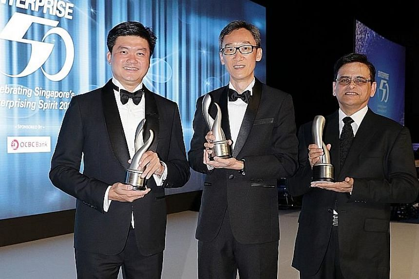 At the Enterprise 50 Awards were (from left) Mr Lee Yong Miang, managing director of Expand Construction which clinched third place; Mr Lam Keng Yew, managing director of Onn Wah Precision Engineering which won the top prize; and Mr Naarayan Raaghava