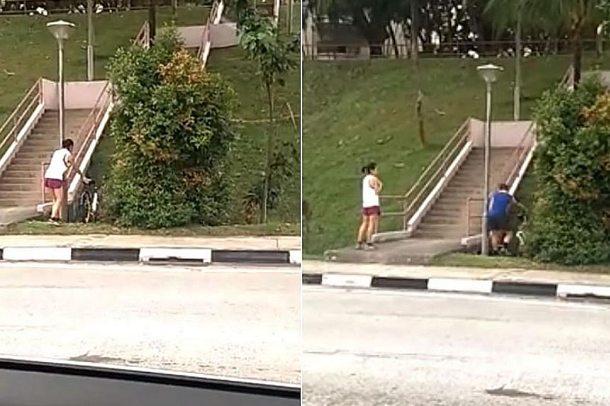 The video shows a man and a woman wheeling a bicycle each into a drain. The incident is believed to have occurred on Sunday afternoon in Lower Delta Road.