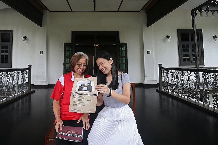 Touch Senior Activity Centre's Ms Maria Yee, 60, going through the conversation starter kit with Ms Koh Wee Xin, 24, a facilitator from Touch Community Services.