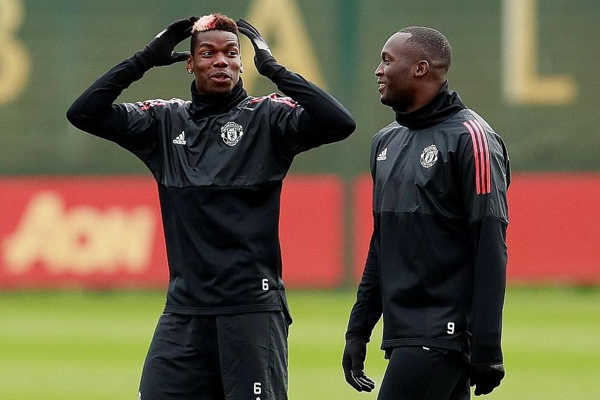Manchester United's Romelu Lukaku and Paul Pogba (left) share a light moment in training ahead of their match against Basel. Pogba's return to the side has already reaped dividends for Jose Mourinho's men against Newcastle, and may yet edge them to t