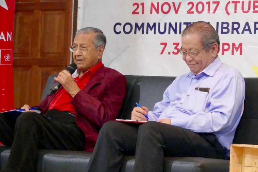 "Former premier Mahathir Mohamad and fellow opposition stalwart Lim Kit Siang speaking to young voters at ""WhatSayYouth"" townhall in Petaling Jaya on Tuesday (Nov 21)."