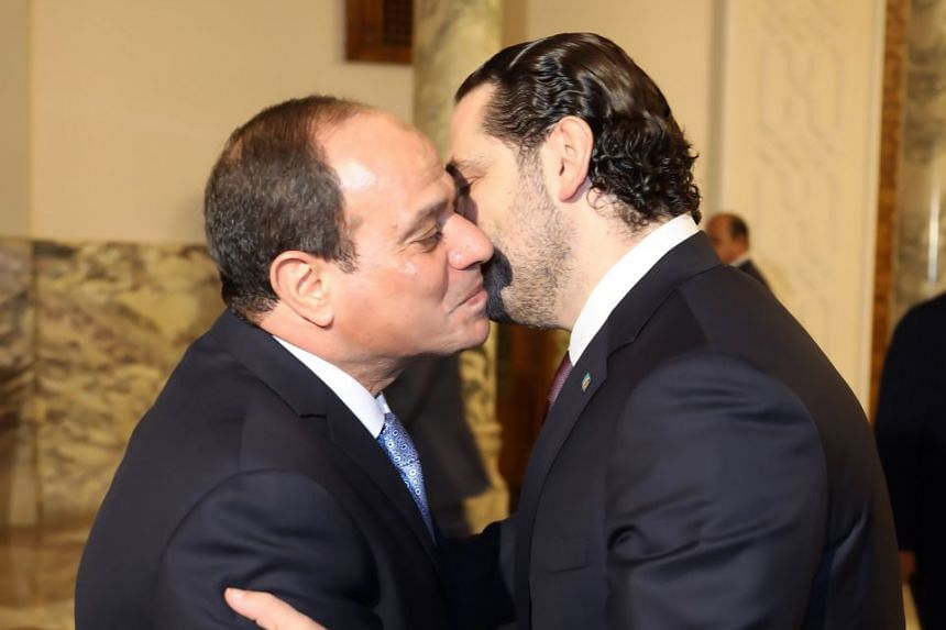 Hariri (right) being greeted by Egyptian President Abdel Fattah al-Sisi upon his arrival in Cairo.