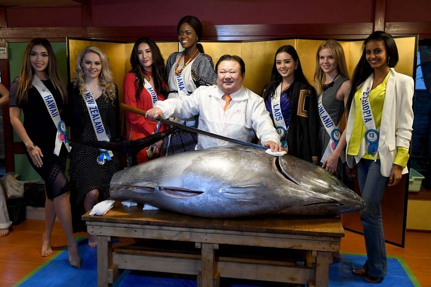 Contestants for the Miss International beauty pageant - held in Japan on Nov 14, 2017 - pose with a sushi chain president and a 250kg bluefin tuna.