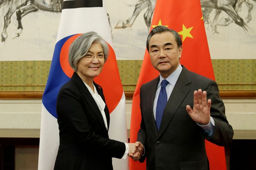 South Korean Foreign Minister Kang Kyung Wha (left) and Chinese Foreign Minister Wang Yi at the Diaoyutai State Guesthouse in Beijing, on Nov 22, 2017.