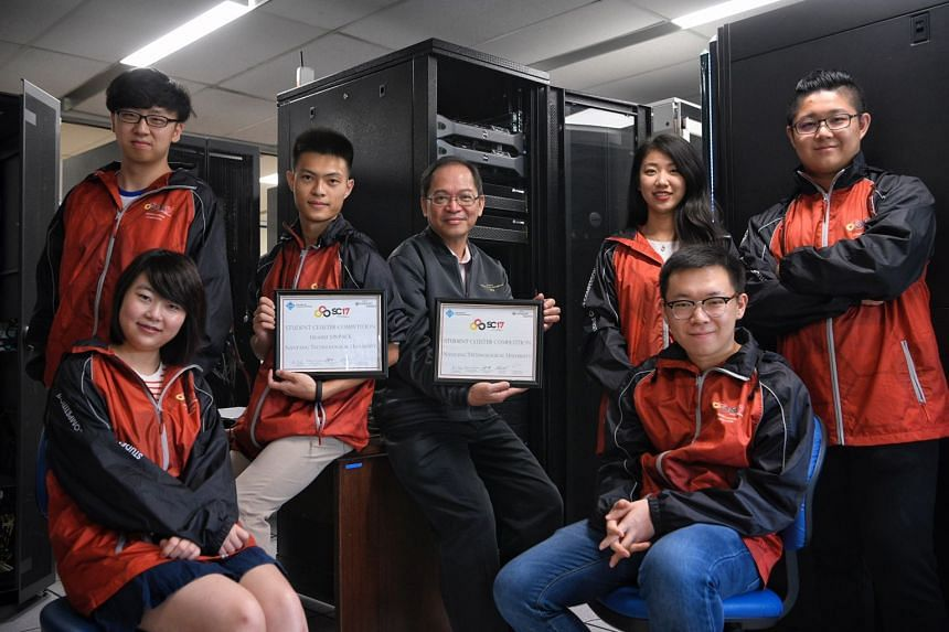 Nanyang Technological University (NTU), represented by a team comprising six undergraduates, bagged the top prize. (From left) Hao Meiru (seated), Shao Yiyang, Chen Hailin, teacher-in-charge Professor Francis Lee, Tang Shuqian, Shi Ziji, and team cap
