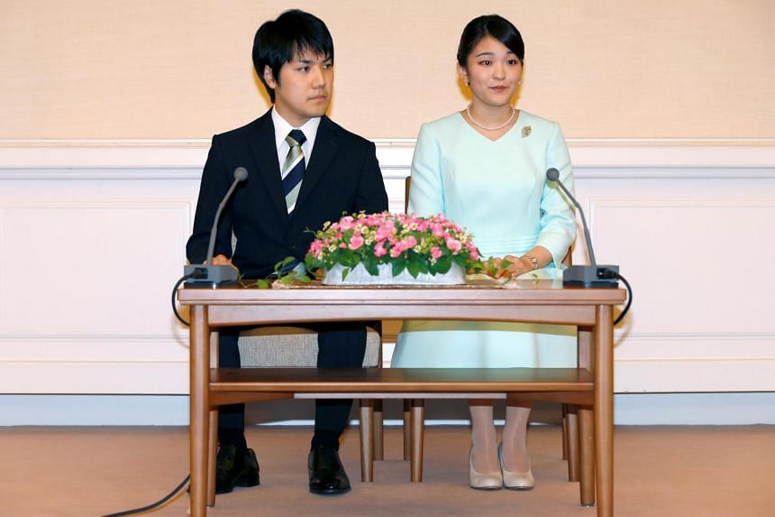 Princess Mako speaks to media with her fiancee Kei Komuro during a press conference to announce their engagement at Akasaka East Residence in Tokyo, on Sept 3.