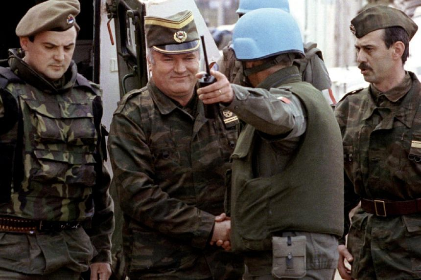 Bosnian Serb wartime general Ratko Mladic (second, left) and a French Foreign Legion officer on his arrival at a failed UN-sponsored meeting in Sarajevo, Bosnia and Herzegovina, on April 12, 1993.
