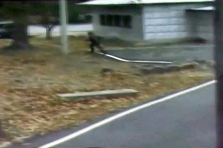 A CCTV footage shows a North Korean soldier crossing the white Military Demarcation Line during a United Nations Command (UNC) briefing on the investigation results of the soldier's defection.