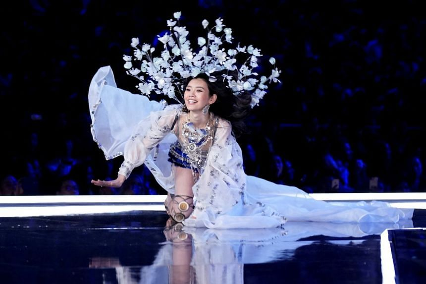 It was a night of glitz, glamour and drama as South African Angel Candice Swanepoel opened the Victoria's Secret Fashion Show, celebrity model Bella Hadid strutted on the runway and Shanghai native Ming Xi (above) fell on stage but maintained her p