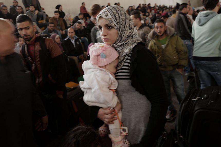 Palestinians wait to cross the Rafah border with Egypt in the southern Gaza Strip, Nov 18, 2017.