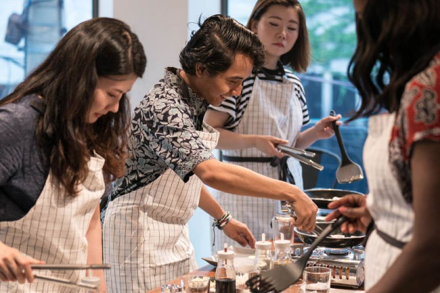 Tourists participating in a cooking class by I Love Hansik at the company's Yeonnam-dong studio on Nov 7, 2017.