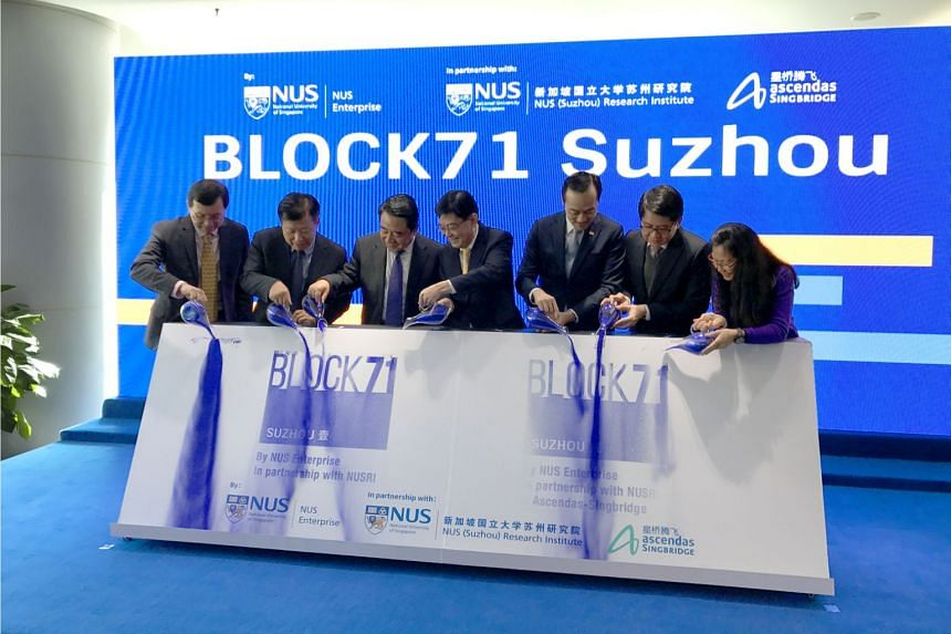 Finance minister Heng Swee Keat (middle, yellow tie) at an event commemorating the extension of BLOCK71 into Suzhou, China yesterday (Nov 23).  From left to right: Mr Aylwin Tan, Chief Customer Solutions Officer, Ascendas-Singbridge; Mr Fang Wei, Dep