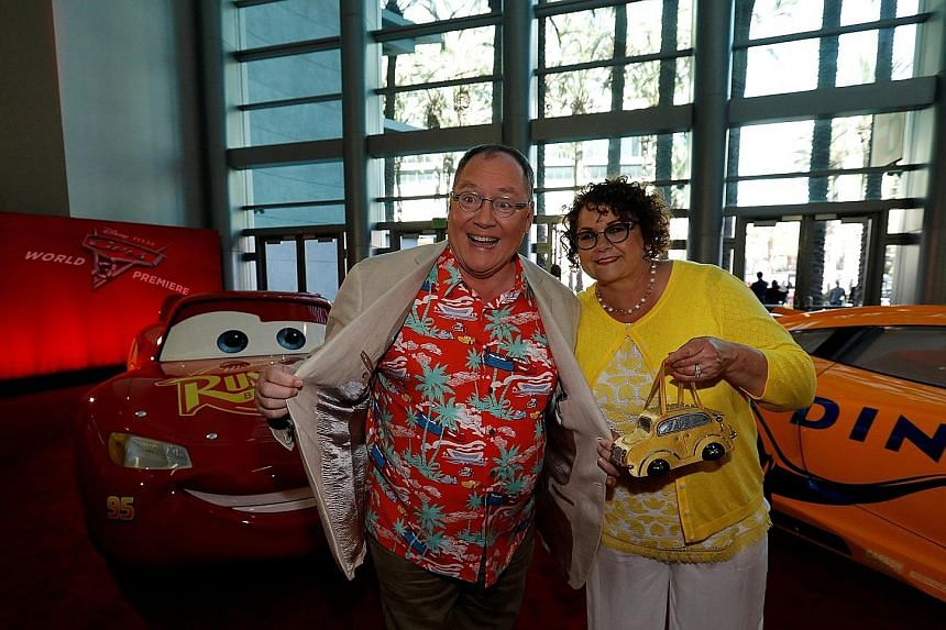 Mr John Lasseter and his wife, Nancy, at the premiere of Cars 3 at the convention centre in Anaheim, California, on June 10. Mr Lasseter has an exuberant public image. At events for Disney fans, he often bounds onto the stage wearing a Hawaiian shirt