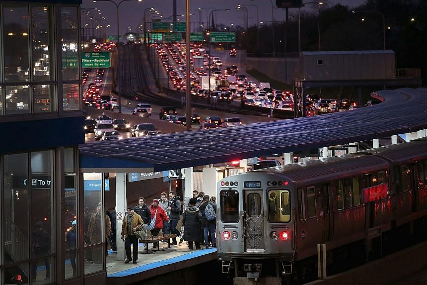 Rush-hour commuters and Thanksgiving holiday travellers in Chicago, Illinois, trying to make their way through the city on Tuesday, with the Kennedy Expressway clogged with cars. Holiday traffic in the city is expected to peak during the Tuesday afte