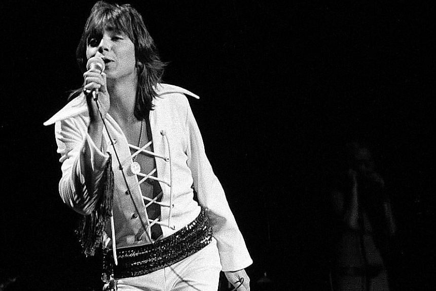 David Cassidy in concert at Madison Square Garden, New York, in 1972 (far left) and the performer in 2009 (left).