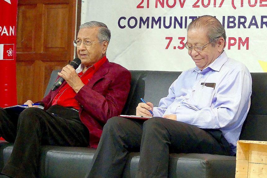 """Political foes turned allies Mahathir Mohamad and Lim Kit Siang sharing a sofa at Harapan's """"WhatSayYouth"""" town hall in Petaling Jaya on Tuesday."""