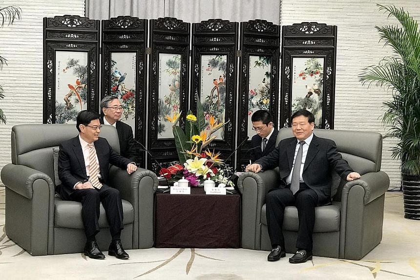 Finance Minister Heng Swee Keat (left) with Jiangsu party secretary Lou Qinjian in Suzhou yesterday. They discussed areas of cooperation and ways for both sides to help companies go international.