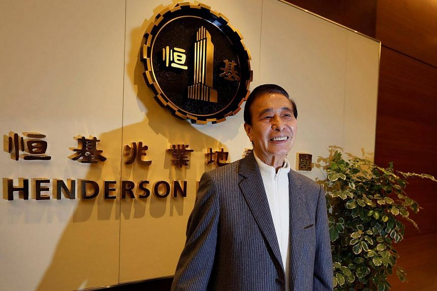 A file photo of tycoon Lee Shau-kee posing in front of the company logo during a news conference in Hong Kong.
