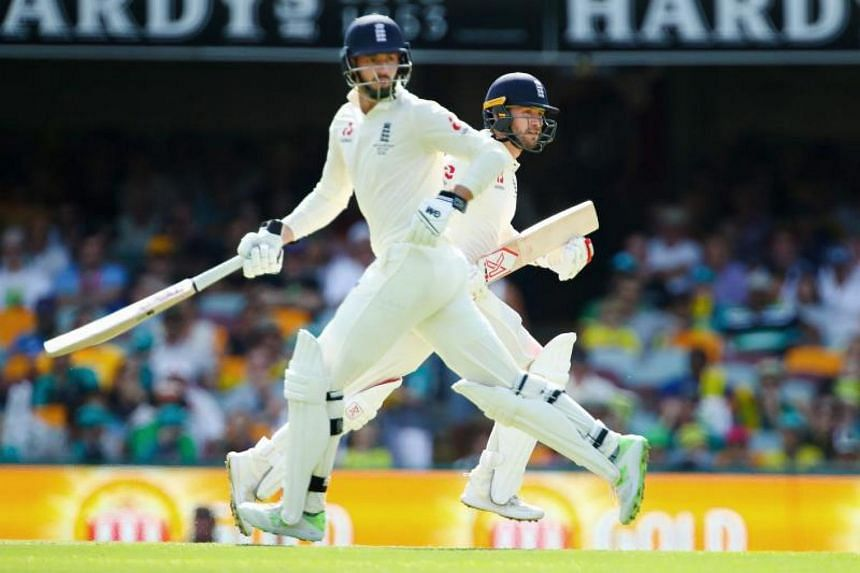 England's Mark Stoneman (right) and James Vince (left) run between the wickets on the first day of the first cricket Ashes Test between England and Australia in Brisbane on Nov 23, 2017.