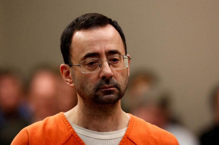 Former USA Gymnastics team doctor Lawrence Nassar, accused of molesting dozens of female athletes over several decades, appears at Ingham County Circuit Court in Lansing, Michigan, on Nov 22, 2017.