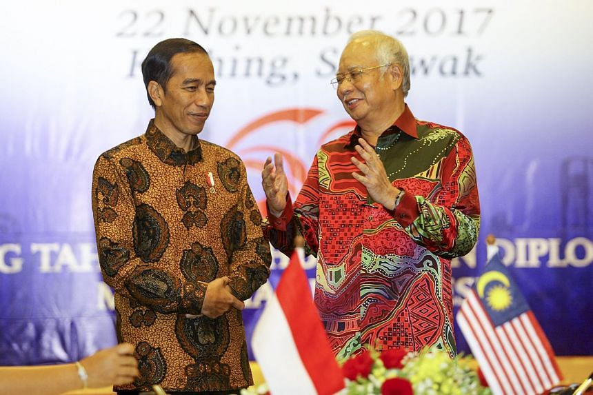 Malaysian Prime Minister Najib Razak (right) and Indonesian President Joko Widodo at the 12th Malaysia-Indonesia annual consultative meeting in Kuching, Sarawak, on Nov 22, 2017.