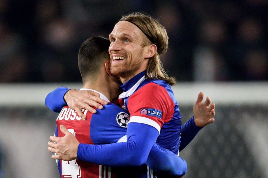 Basel's Swiss defender Michael Lang (right) celebrates scoring the only goal.