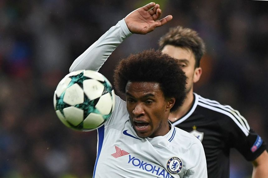 Chelsea midfielder Willian in action during the match.