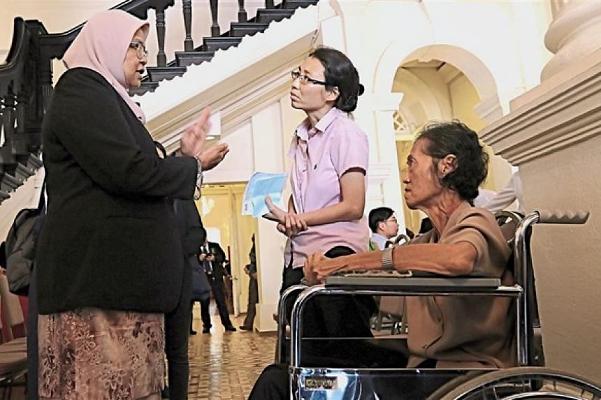 Datuk Maimunah Mohd Sharif explaining to Ooi Chee Lin and her mother why she was fined for parking in a disabled lot.