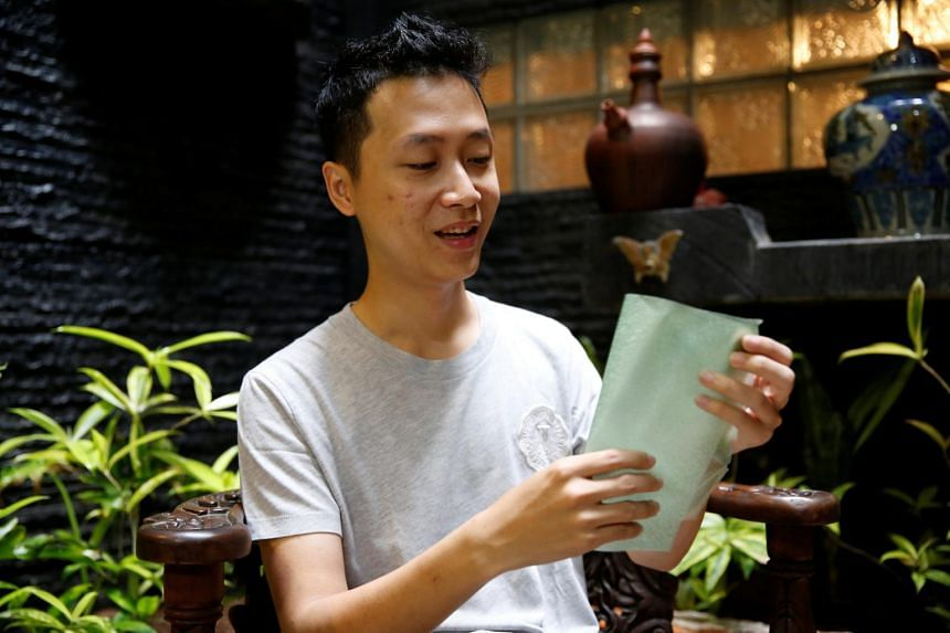 David Christian, co-founder of Evoware, holds a piece of seaweed for packaging during an interview at his home in Jakarta on Oct 26, 2017.