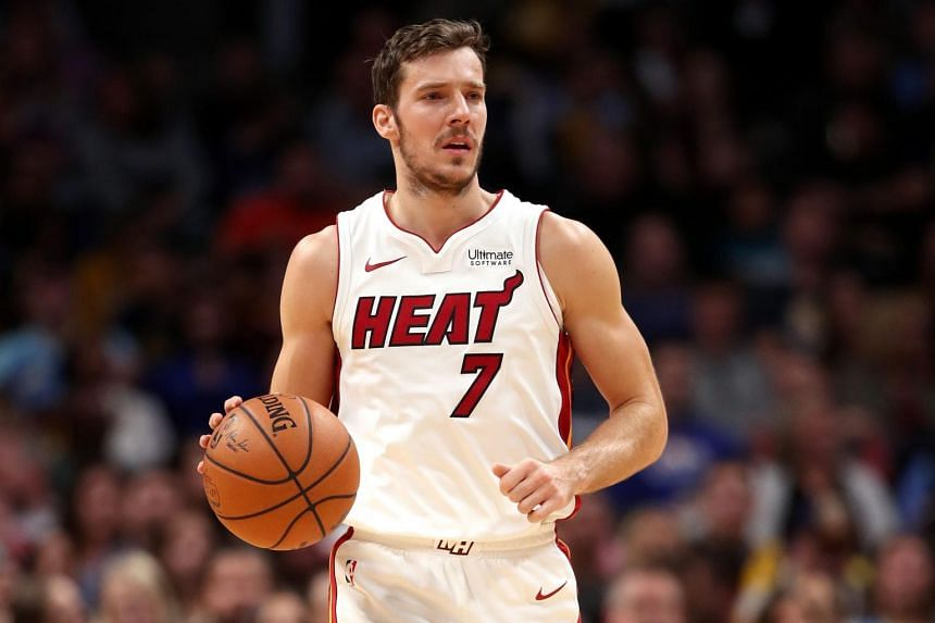 Goran Dragic #7 of the Miami Heat brings the ball down the court against the Denver Nuggets at the Pepsi Center in Denver, Colorado.
