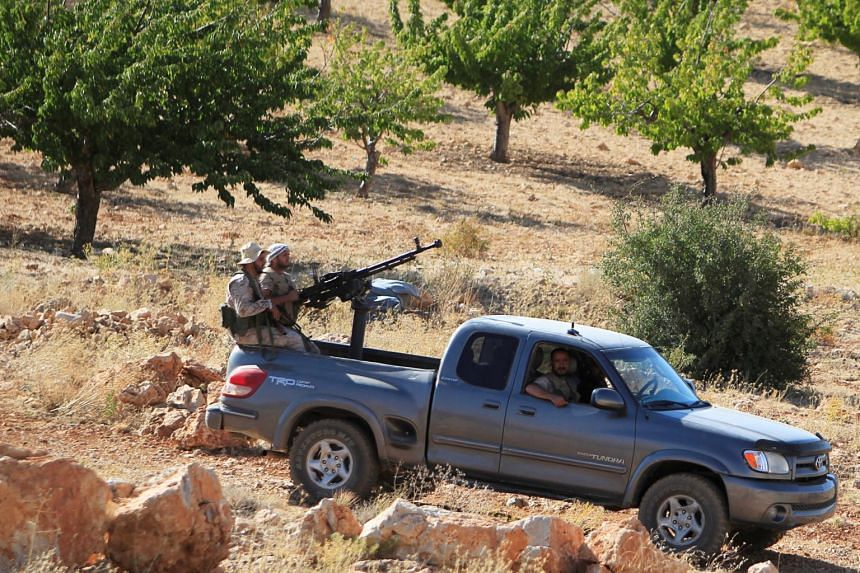 Hizbollah fighters in a truck in Jroud Arsal, near Syria-Lebanon border, on Aug 13, 2017.