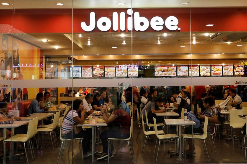 Customers eat at a Jolibee fastfood outlet in Quezon City, Manila.