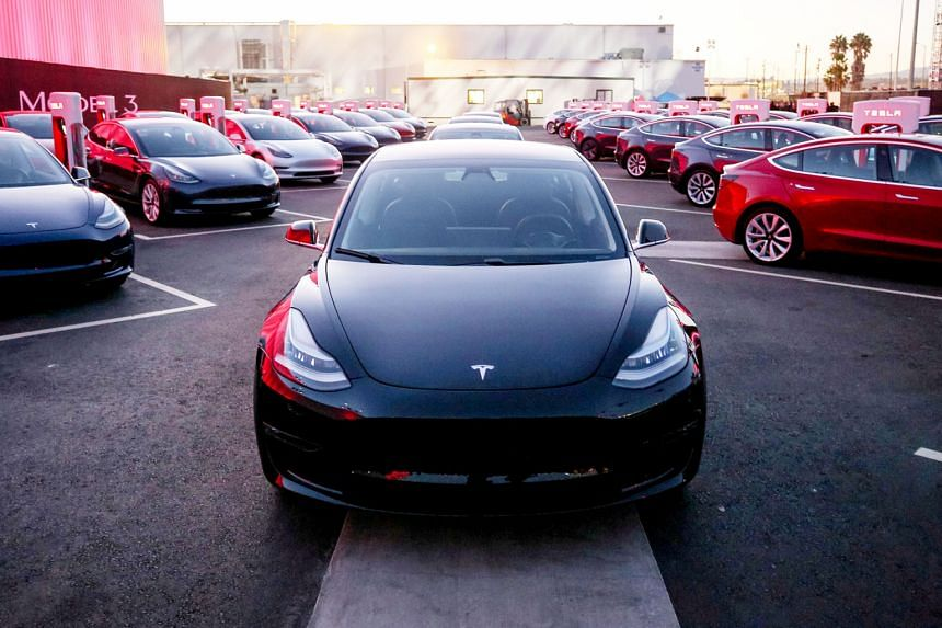 Tesla Model 3 cars at a factory in California. Tesla has said it is ramping up output of the model, which will bring money in the door. It has a target of producing 5,000 of the sedans by the end of March next year.