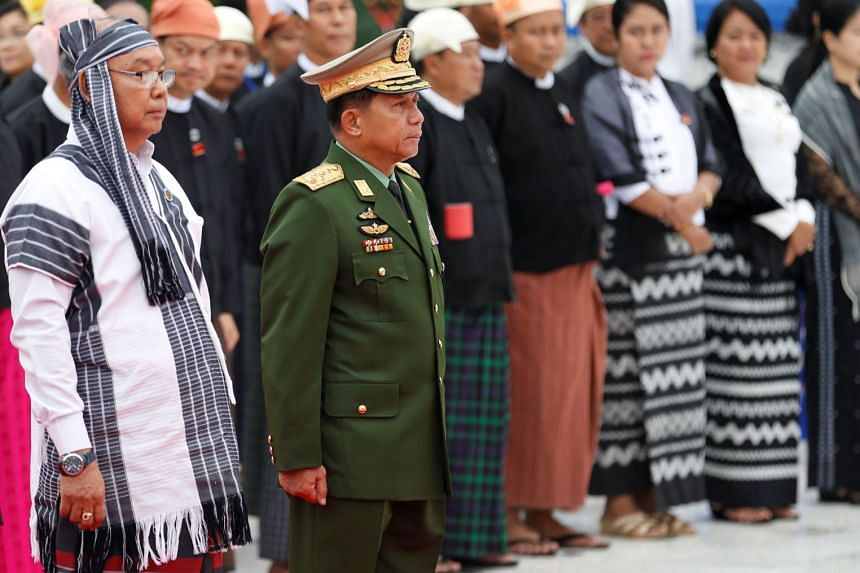 Senior General Min Aung Hlaing (second left) attending an event in Yangon in July 2017.