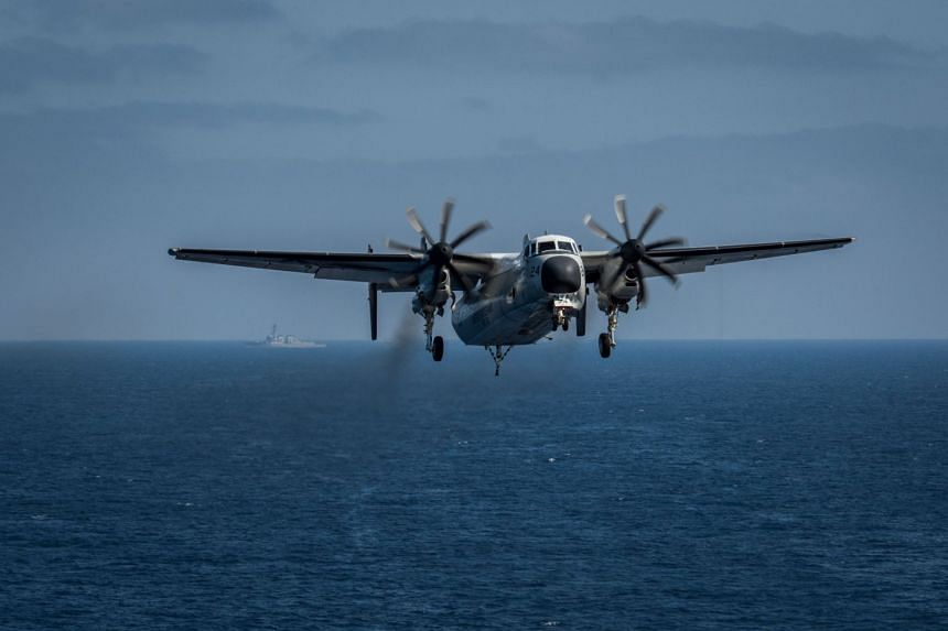 A file photo of C-2A Greyhound prepares to land on the flight deck aboard the aircraft carrier USS Theodore Roosevelt, on Aug 22.