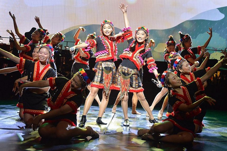 Singers Natanya Tan (left) and Verlene Chew, both 12, are flanked by the Dance Inspiration team as they perform the Taiwan segment of ChildAid at one of the final full-dress rehearsals yesterday for the charity concert. Titled An Amazing, Awesome Asi