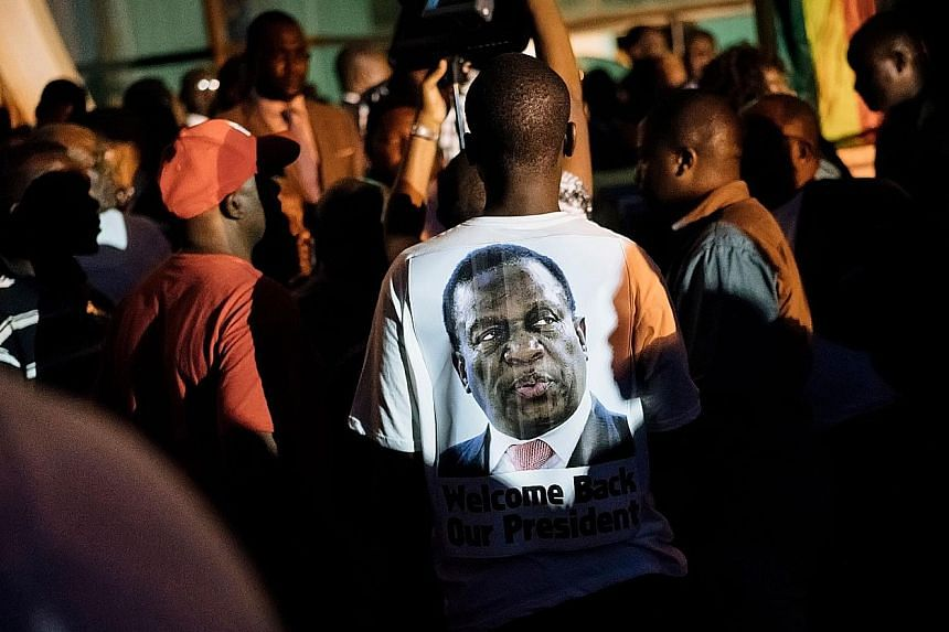 A Mnangagwa supporter wearing a T-shirt emblazoned with the incoming president's image at the headquarters of Zimbabwe's ruling Zanu-PF party in Harare on Wednesday. Mr Emmerson Mnangagwa will be sworn in as president today.