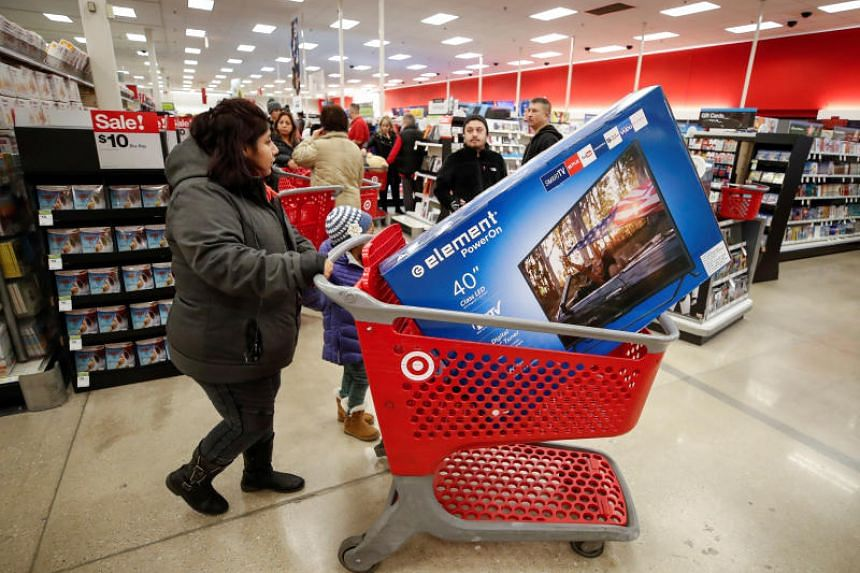 A customer navigates through the aisles during the Black Friday sales event on Thanksgiving Day at Target in Chicago on Nov 23, 2017.