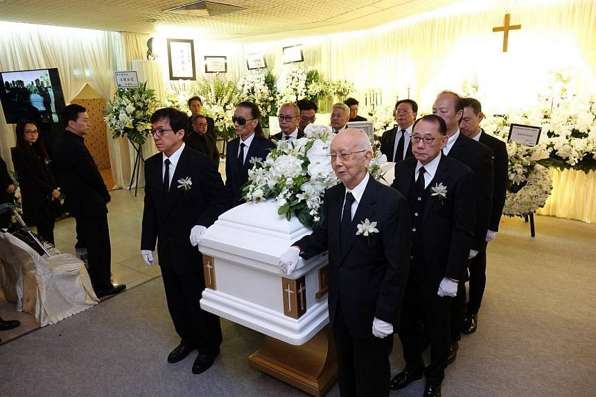 Pallbearers at the funeral of film producer and manager Willie Chan: On the left side are Jackie Chan, Patrick Tse,  Daneil Lam and Stanley Kwan. On the right side are Raymond Chow, Albert Yeung, Ti Lung and Jacky Cheung.