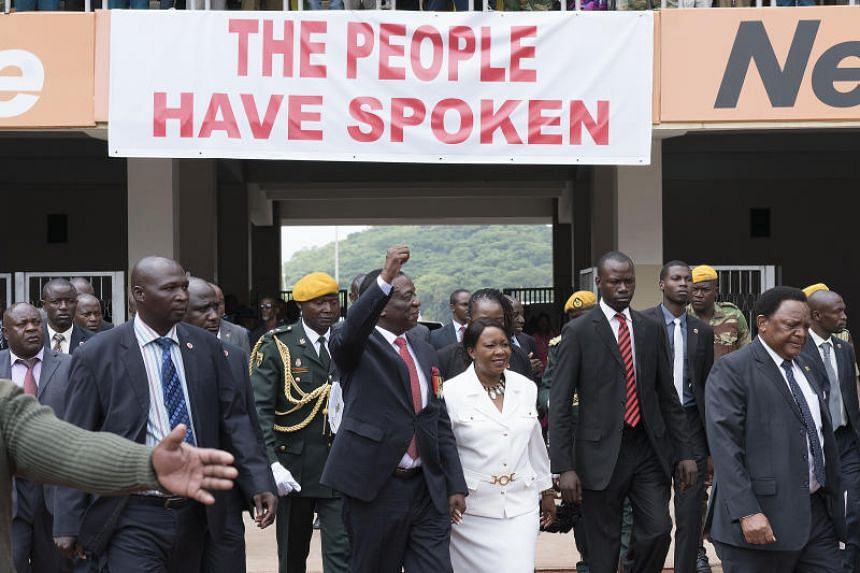 President Elect Emmerson Mnangagwa Centre Gestures As He Arrives With His Wife Auxilia At