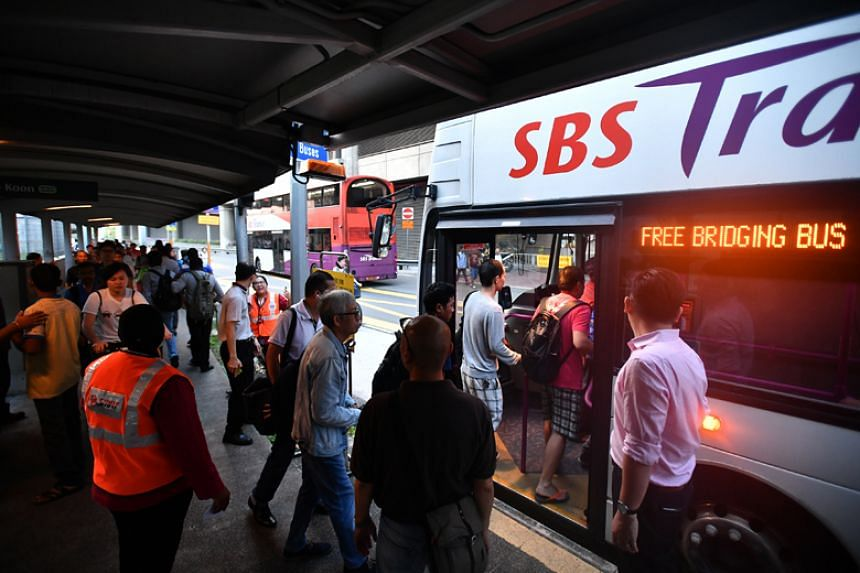 Commuters taking the free shuttle bus services between Joo Koon and Gul Circle stations, which will remain in place till at least June 2018 while train service between the two stations is suspended.