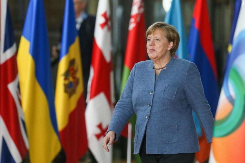German acting Chancellor Angela Merkel arrives for the EU Eastern Partnership Summit in Brussels on Nov 24, 2017.