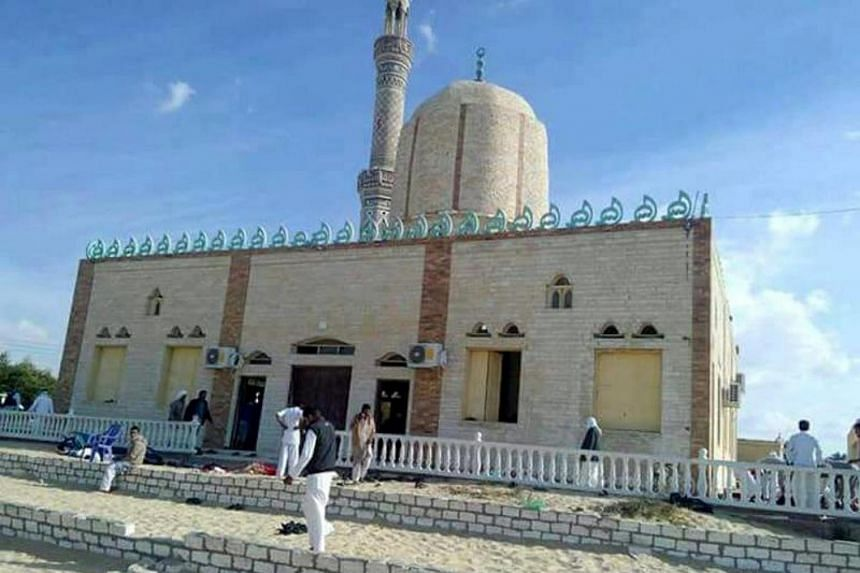 Suspected militants set off a bomb and opened fire at Al Rawdah mosque in Bir al-Abed, Arish, Egypt on Nov 24, 2017.