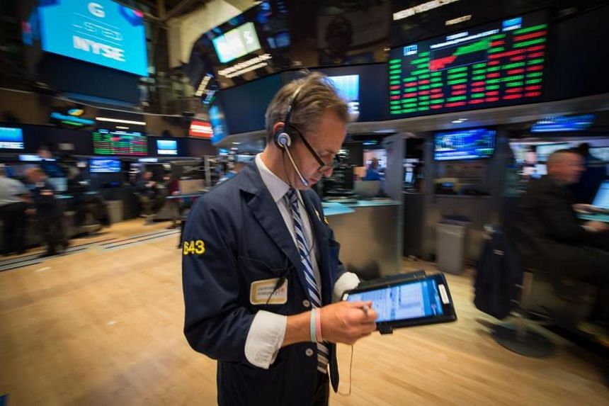 A trader works on the floor at the closing bell of the Dow Industrial Average at the New York Stock Exchange on Nov 8, 2017.