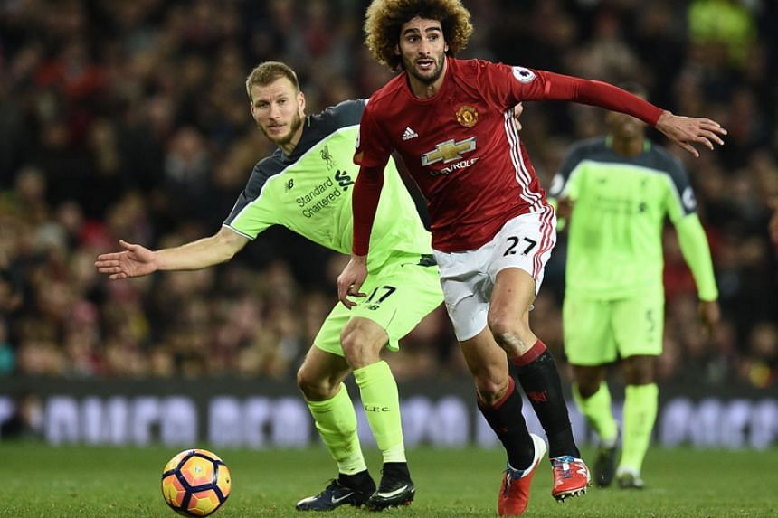 Manchester United's Marouane Fellaini says his New Balance boots have had a negative impact on his performances.