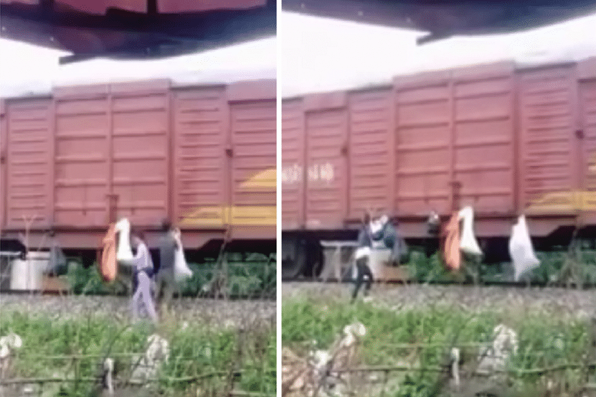 Rsidents of Huong Khe town in the north-central province of Ha Tinh hanging bags of trash on the side of a train that had stopped at the station.