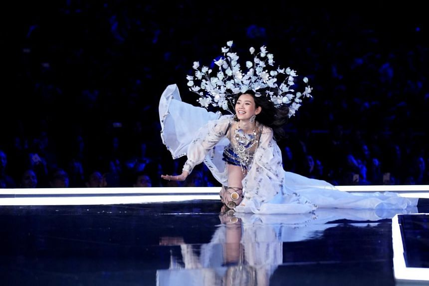 Model Ming Xi falls as she presents a creation during the 2017 Victoria's Secret Fashion Show in Shanghai, China.