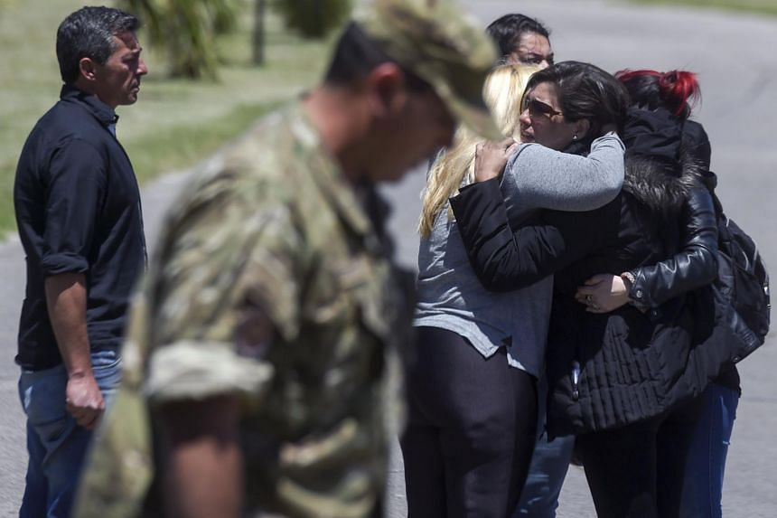 Relatives and comrades of 44 crew members of Argentine missing submarine express their grief at Argentina's Navy base in Mar del Plata on Nov 23, 2017.