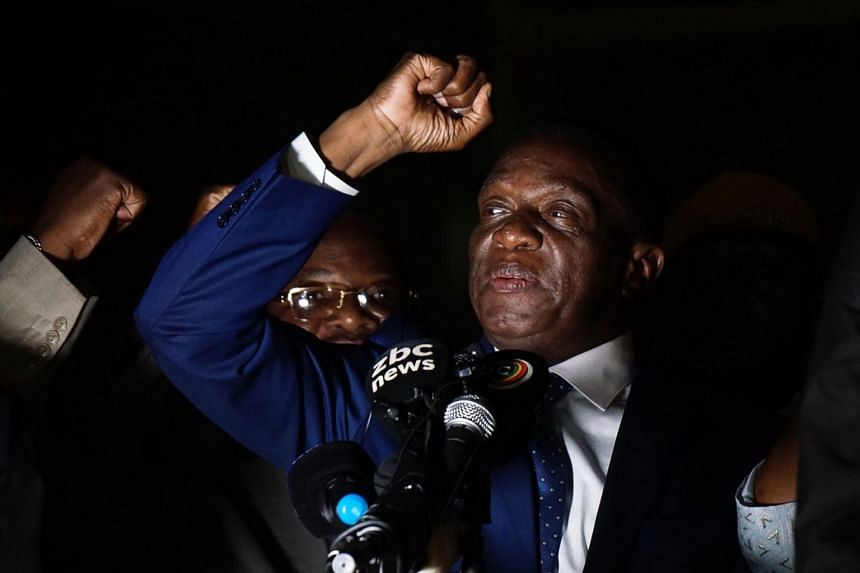 Zimbabwe's incoming president Emmerson Mnangagwa gestures as he speaks at Zimbabwe's ruling Zanu-PF party headquarters in Harare.